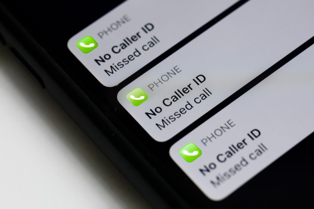 """Smartphone screen showing missed calls from """"No Caller ID"""" numbers."""